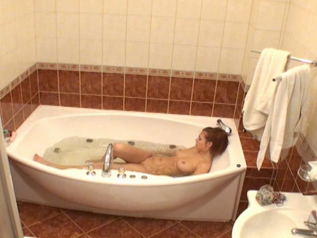 Superb busty redhead voyeur babe Atlantida taking a bath on spy camera