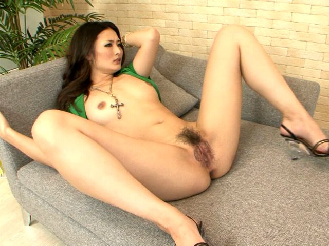 Sweet and sexy Japan minx Risa gets hairy pussy licked by a horny guy on the couch