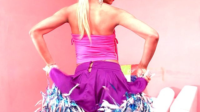 sweet-blonde-shemale-cheerleader-itiel-dancing-and-showing-assets-upskirt_01