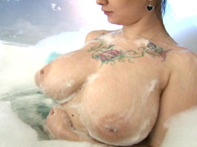Sweet brunette exgirlfriend Jennique  showing her sexy tattoos and big jugs in bubble bath