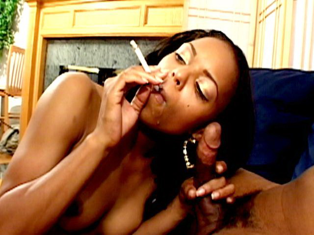 Sweet chocolate nymph Marie Luv smoking and sucking a big black phallus on her knees