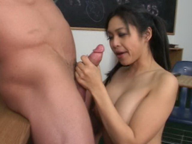 Sweet pigtailed asian schoolgirl Mika Tan teasing her teacher in classroom Erotic Asians XXX Porn Tube Video Image