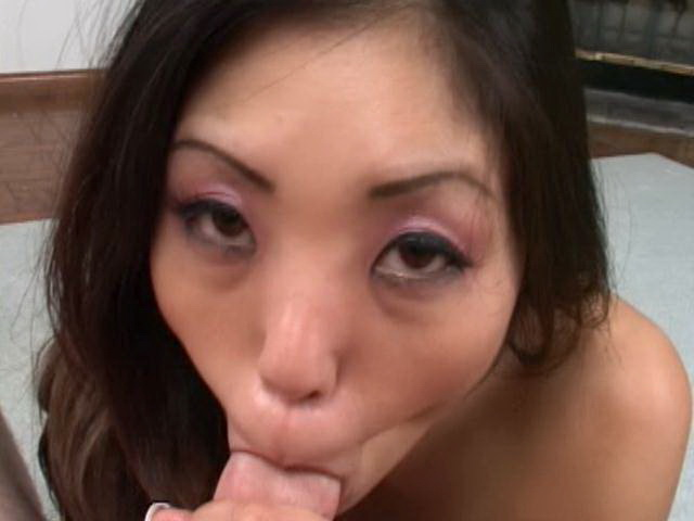 Sweety Asian nymphet sucking a monster dick on her knees in POV