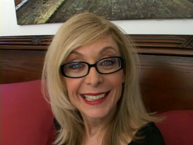 Sweety blonde granny in glasses Nina Hartley talking dirty in the bedroom Is That Grandma XXX Porn Tube Video Image