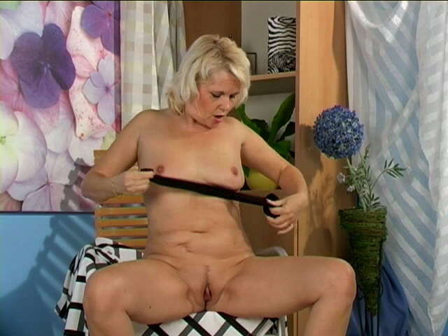 Sweety blonde granny Leona touching her body with lust