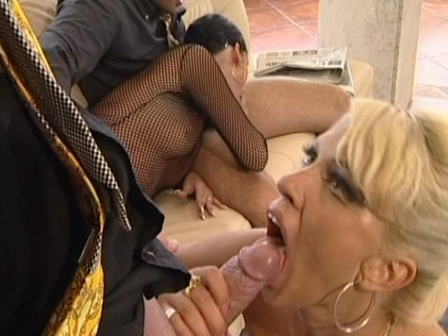 Sweety chicks sucking two massive cocks with lust on the couch 18 Passport XXX Porn Tube Video Image
