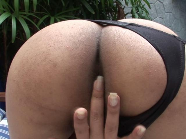 Sweety tranny Giselle rubbing her tight asshole at the poolside