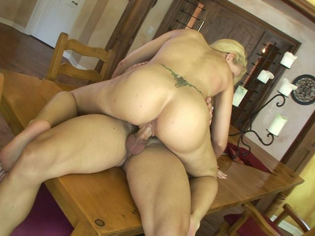 Tattooed blonde nympho Heidi Johnny gets fucked on the kitchen table