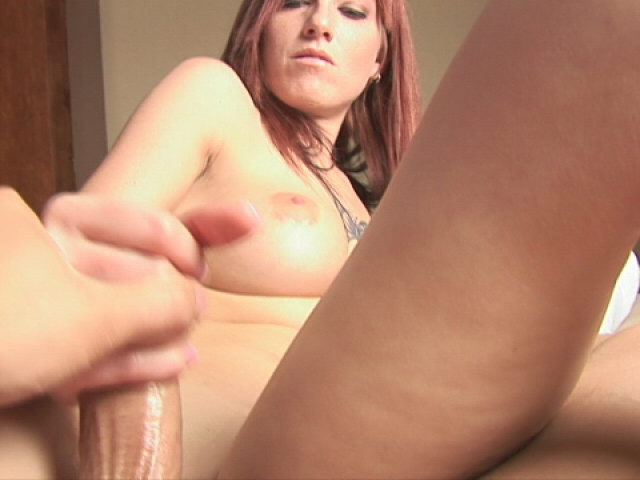 Tattooed busty girl Tricia wanking a giant schlong like crazy