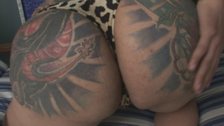 Tattooed Shemale Penelope Jolie Showing Large Boobs And Stripping Leopard Bikini