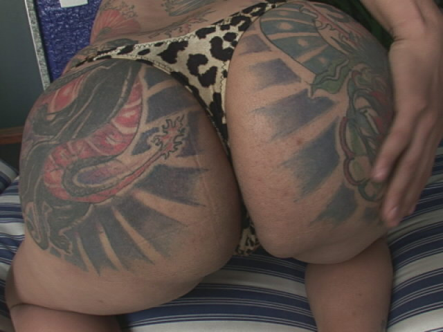 Tattooed Shemale Penelope Jolie Showing Large Boobs And Stripping Leopard Bikini Shemale Lolipops XXX Porn Tube Video Image
