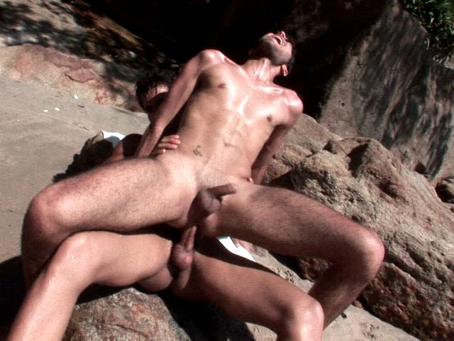 Tempting brunette gay Kaike gets skinny ass hammered by Junior Bastos on the rocks