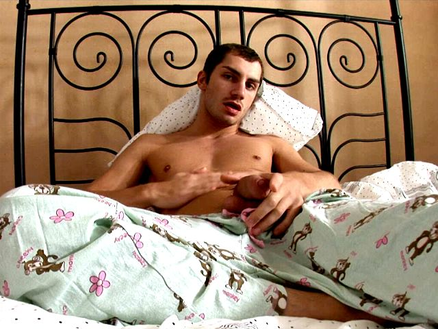 Tempting brunette gay Tommy jerking off his enormous dick and fingering his sexy asshole on camera