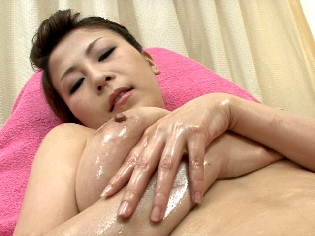 Tempting Japan cutie Yuki Aida fingering her sweet oiled pussy in close-up Erotic Japan XXX Porn Tube Video Image