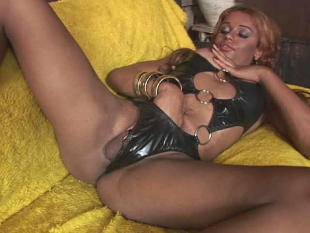 Tempting shemale Veronica teasing us with her fuckable arse on the couch Shemale Lolipops XXX Porn Tube Video Image