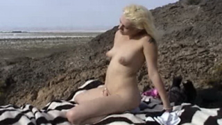 Topless amateur blonde nymphet masturbating pussy outdoors