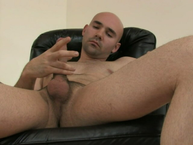 Trashy bald gay Bucky jerking off his massive schlong on the armchair Gay Sex Exposed XXX Porn Tube Video Image