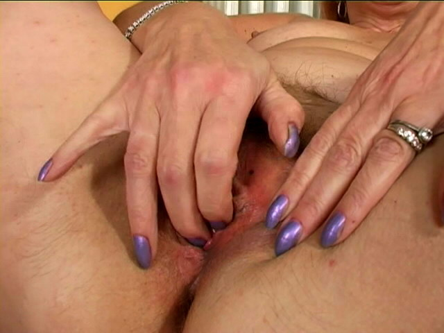 Trashy blonde granny Lady spreading and fingering her hairy beaver in bedroom
