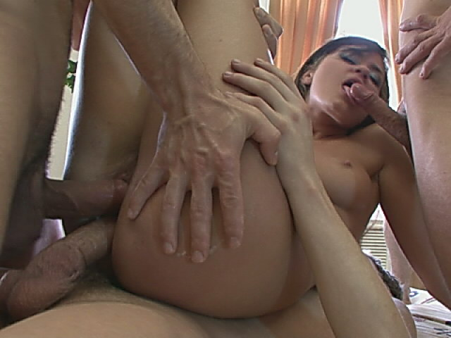 Trashy brunette chick getting double penetrated while she gives blow job