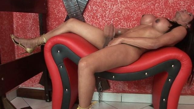 trashy-brunette-tranny-with-large-knockers-chelsie-masturbating-on-the-couch_01