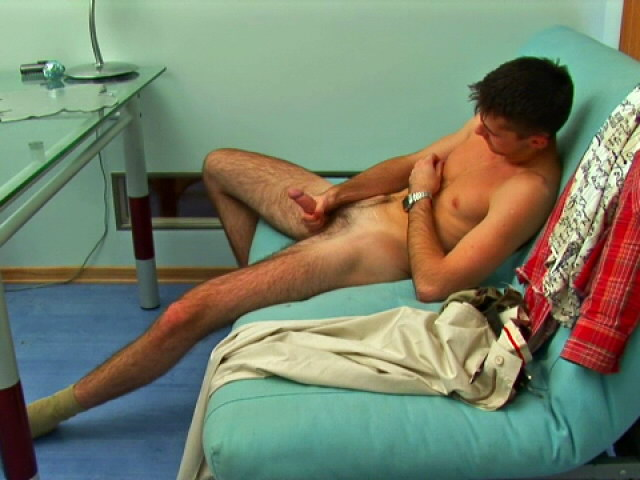 Trashy gay stripping seductively and playing with his thick penis