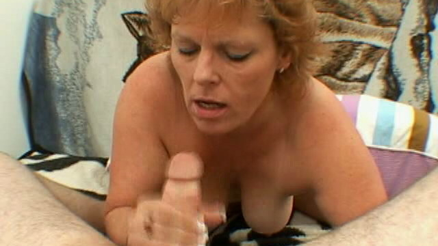 trashy-granny-with-large-tits-megan-gives-blowjob-and-handjob-on-her-knees_01