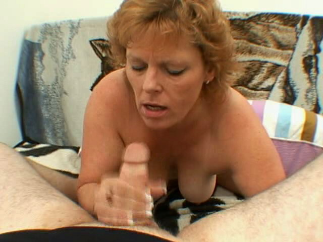 Trashy granny with large tits Megan gives blowjob and handjob on her knees