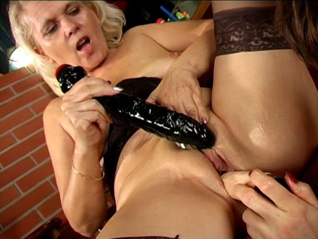 Trashy lesbian grannies Marketa And Leona licking their succulent pussies and sharing a giant dildo Is That Grandma XXX Porn Tube Video Image