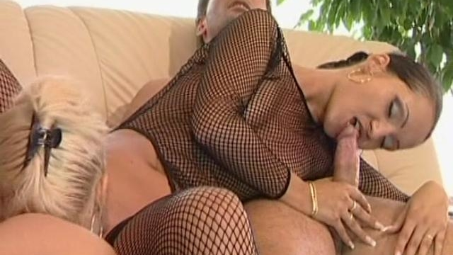 two-hot-young-lesbians-in-fishnets-sharing-a-giant-dick_01