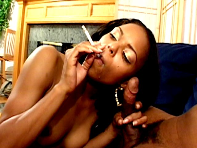 Ultra sexy ebony nympho Marie Luv smoking and slurping a giant black penis