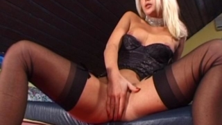 Uninhibited blonde babe in stockings playing with her delicious pussy
