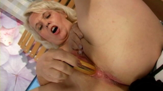 Uninhibited blonde granny Leona spreads legs and masturbates her wet slit