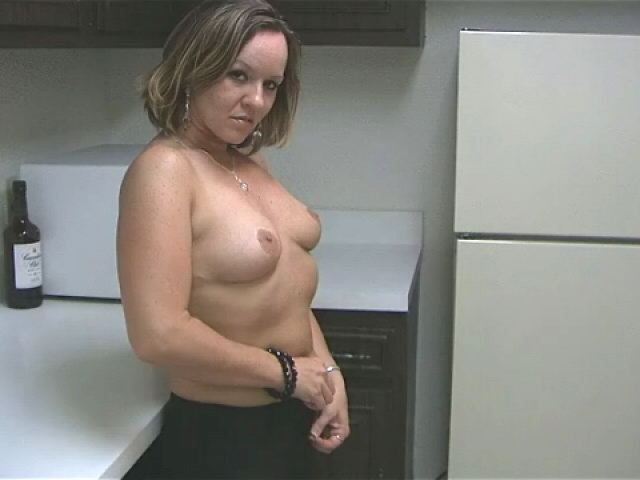 Voluptuous blondie wife Tessa touching her sexy body with lust in the kitchen Tessa Wife XXX Porn Tube Video Image