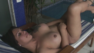 Voluptuous brunette shemale Penelope Jolie shows big tits and hard prick at the pool