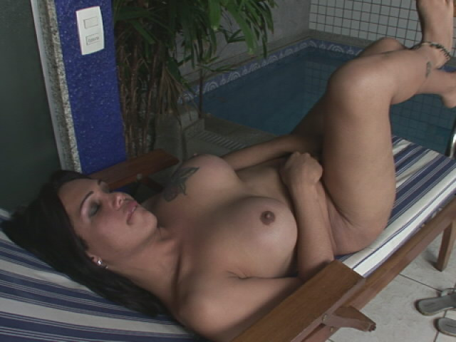 Voluptuous brunette shemale Penelope Jolie shows big tits and hard prick at the pool Shemale Lolipops XXX Porn Tube Video Image