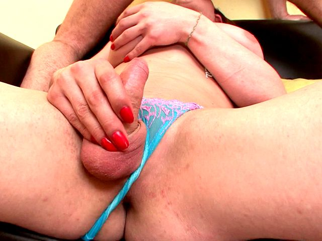 Winsome redhead shemale bitch Karla wanking cock while getting mouth fucked by a monster shaft on the couch
