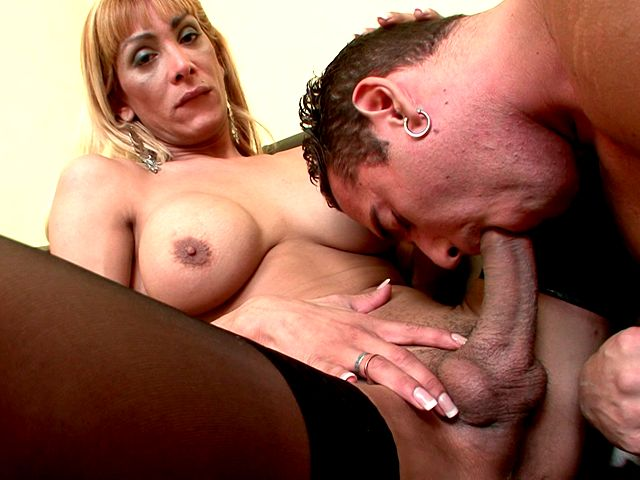 Winsome stockinged blonde shemale cheerleader Celeste gets giant dick sucked by a hot stud Shemale Lolipops XXX Porn Tube Video Image